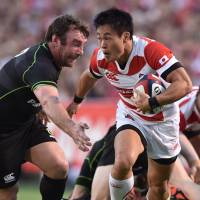 Japan's Kenki Fukuoka runs with the ball during the Brave Blossoms' 45-20 defeat to the World XV at Prince Chichibu Memorial Ground on Saturday. | AFP-JIJI