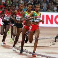 Ethiopia's Almaz Ayana leads compatriot Genzebe Dibaba during the women's 5,000-meter final at the IAAF World Championships in Beijing on Sunday. | AP