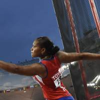 Cuba's Denia Caballero competes in the women's discus final at the IAAF World Championships on Tuesday in Beijing. | AFP-JIJI