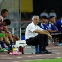 Japan manager Vahid Halilhodzic watches his team's 1-1 draw with South Korea at the East Asian Cup on Aug. 5 in Wuhan, China.   AFP-JIJI