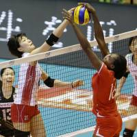 Riho Otake (left) competes against Kenya during their match at the FIVB Women's World Cup at Yoyogi National Gymnasium on Wednesday. | KYODO