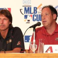 Former Arizona Diamondbacks stars Luis Gonzalez (right) and Randy Johnson, who now work in the team's front office, attend a news conference in Tokyo on Tuesday. | KAZ NAGATSUKA