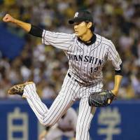 Tigers pitcher Fujinami's double provides spark for solid performance on mound