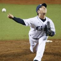 Lions starter Ken Togame pitches against the Marines on Friday at Seibu Prince Dome. Seibu defeated Chiba Lotte 7-6. | KYODO