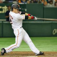 Yasuyuki Kataoka hits his second home run of the game during the Giants' 9-5 win over the Dragons at Tokyo Dome on Sunday. | KYODO