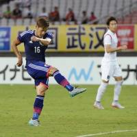 Yamaguchi scores equalizer as Japan grabs point in draw against South Korea