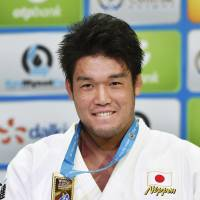 Haga secures under-100-kg title at judo worlds