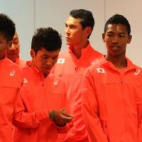 Sprinter Abdul Hakim Sani Brown (far right), 16, seen at Thursday's news conference in Tokyo, is the youngest athlete to ever be named to Japan's senior national track and field team. | KAZ NAGATSUKA