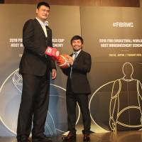 Yao Ming and Manny Pacquiao promote their nations' bids for the 2019 FIBA World Cup and pose for a photo on Friday morning in Tokyo. | KAZ NAGATSUKA