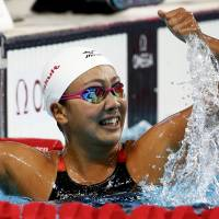 Kanako Watanabe celebrates winning the 200-meter breaststroke final at the world championships on Aug. 7. | REUTERS