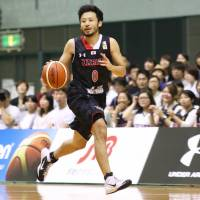 Japan guard Yuta Tabuse dribbles the ball during Friday's exhibition game against Czech Republic at Chiba Port Arena. The Czech Republic beat Japan 68-66. | KAZ NAGATSUKA