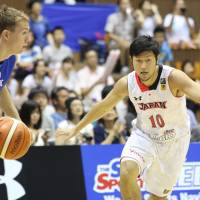 Japan guard Ryoma Hashimoto exhibits gritty defense against a Czech Republic player during Saturday's game at Yoyogi National Gymnasium Annex.  Japan beat the visitors 65-54. | KAZ NAGATSUKA