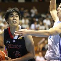 Japan forward Joji Takeuchi looks to take a shot underneath the basket during his team's 75-61 exhibition win over the Czech Republic on Sunday. | KAZ NAGATSUKA