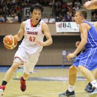 Japan's Kenta Hirose looks to drive into the lane against the Czech Republic during Saturday's game. | KAZ NAGATSUKA