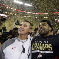 Ohio State coach Urban Meyer (left) looks to lead the Buckyes to a second straight national title this season. | AP