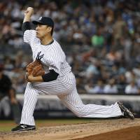 Yankees starting pitcher Masahiro Tanaka delivers during Tuesday's 13-3 win over the Red Sox. | AP