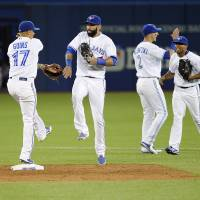 Blue Jays bash three homers to bury Twins