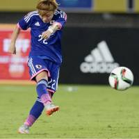 Ami Sugita scores a second-half goal in Japan's 4-2 loss to North Korea in the teams' East Asian Cup opener on Saturday in Wuhan, China. | KYODO