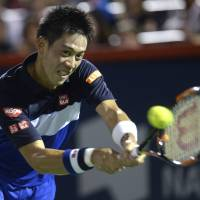 Kei Nishikori plays a shot during his 6-3, 6-0 defeat to Andy Murray in the Rogers Cup semifinals in Montreal on Saturday. | AP