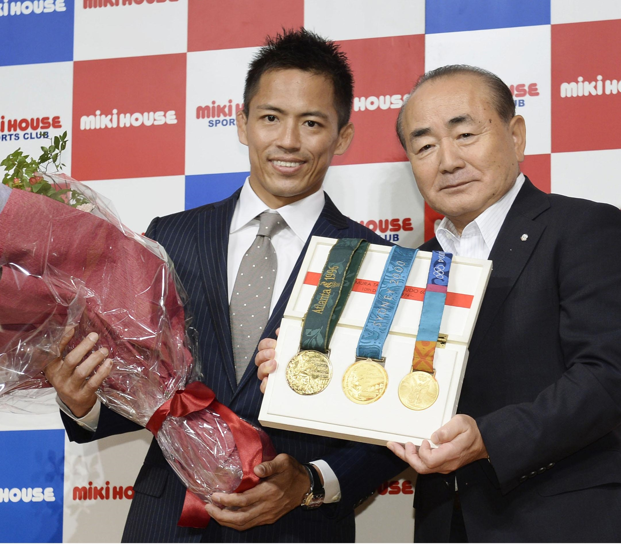 Tadahiro Nomura (left), a three-time Olympic judo champion at 60 kg, attends a Monday news conference in Osaka. | KYODO