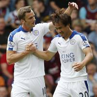 Shinji Okazaki is congratulated by Leicester City teammate Andy King after scoring against West Ham United in the Premier League on Saturday. | AFP-JIJI