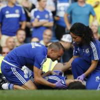 Chelsea doctor Eva Carneiro (right) has been relieved of match-day duties after manager Jose Mourinho, criticized her after she ran on the pitch to treat Eden Hazard in stoppage time last Saturday. | AFP-JIJI