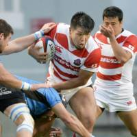 Japan's Shota Horie carries the ball against Uruguay during a test match on Saturday in Fukuoka. The Brave Blossoms defeated the visitors 30-8. | KYODO