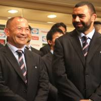 Japan coach Eddie Jones and captain Michael Leitch attend a Monday news conference in Tokyo, where the 31-man Brave Blossoms squad for the 2015 Rugby World Cup was announced. | KAZ NAGATSUKA