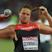Germany's Christina Schwanitz competes in the women's shot put final during the IAAF World Championships at the Bird's Nest in Beijing on Saturday. | AFP-JIJI