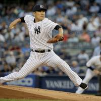 New York starting pitcher Masahiro Tanaka delivers during the first inning of the Yankees' 7-3 defeat to the Indians on Friday. | AP