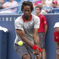 France's Gael Monfils plays a shot from Poland's Jerzy Janowicz in their first-round match at the Western and Southern Open on Monday. Janowicz won 6-4, 7-5 in 1 hour, 15 minutes. | AP