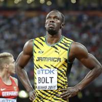 Usain Bolt of Jamaica prepares to compete in the men's 100-meter semifinals at the IAAF World Championships in Beijing on Sunday. | REUTERS