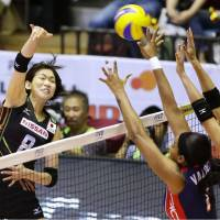 Japan's Sarina Koga spikes the ball against the Dominican Republic in Thursday's FIVB Women's World Cup match at Yoyogi National Gymnasium. | KYODO