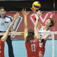 Saori Kimura spikes the ball during Japan's five-set defeat to Russia at the FIVB Women's World Cup on Sunday at Yoyogi National Gymnasium. | KYODO
