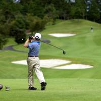 Golf's slide in Japan sees course owners taking a swing at noncorporate clients
