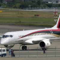 A Mitsubishi Regional Jet (MRJ) passenger aircraft, developed by Mitsubishi Aircraft Corp., taxies during a low speed taxiing test at Nagoya airport in Aichi Prefecture on June 10. | BLOOMBERG
