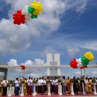 Myanmar and Japanese officials cut ribbons during the opening ceremony of the Thilawa Special Economic Zone at Thanlyin township outside Yangon Wednesday. | REUTERS