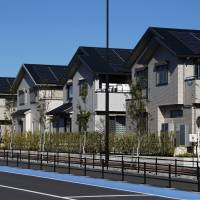 Solar panels developed by Panasonic Corp. are seen on the roofs of houses in a neighborhood where alternative energy is promoted, in Fujisawa, Kanagawa Prefecture, last November. Panasonic will begin selling solar batteries in Europe.   BLOOMBERG