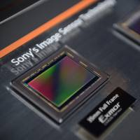 An older Sony Corp. image sensor is displayed at the product's unveiling in Tokyo in October 2013. The electronics giant is developing a next-generation technology that can process 1,000 images a second. | BLOOMBERG