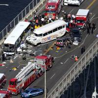 Four killed on Seattle bridge in collision involving bus, tourist-packed WWII-era amphibious duck