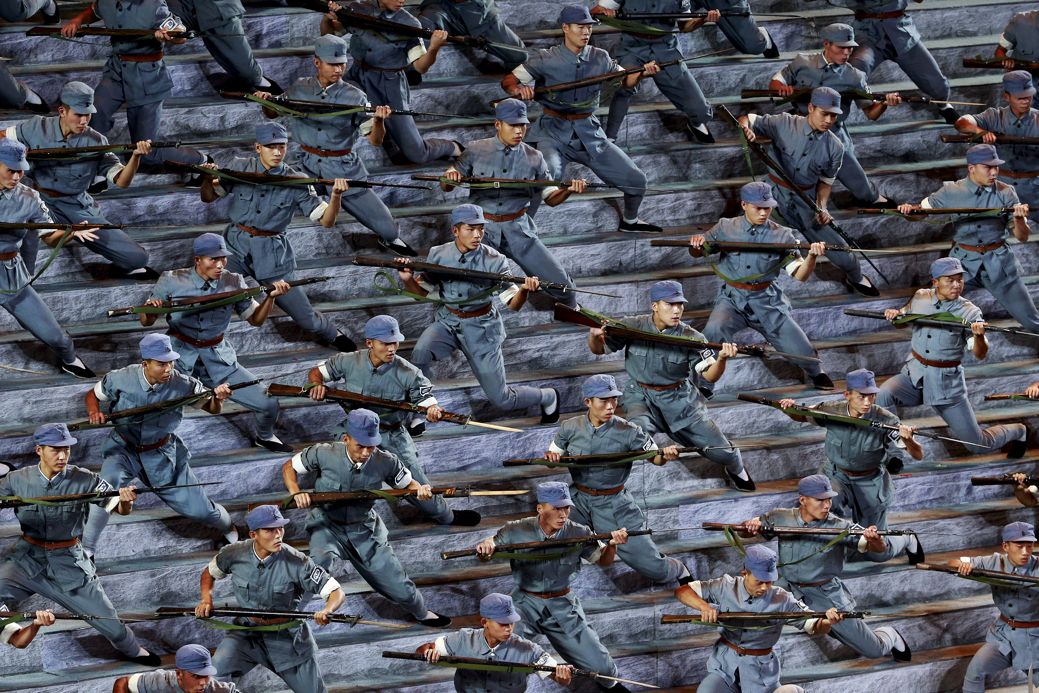 Actors dressed as Red Army soldiers perform at a gala show to mark the 70th anniversary of the end of World War II in Beijing Sept. 3. Bitterness is growing within China's armed forces to President Xi Jinping's decision to cut troop numbers by 300,000 and considerable effort will be needed to overcome opposition to the order, according to a source and commentaries in the military's newspaper.   REUTERS