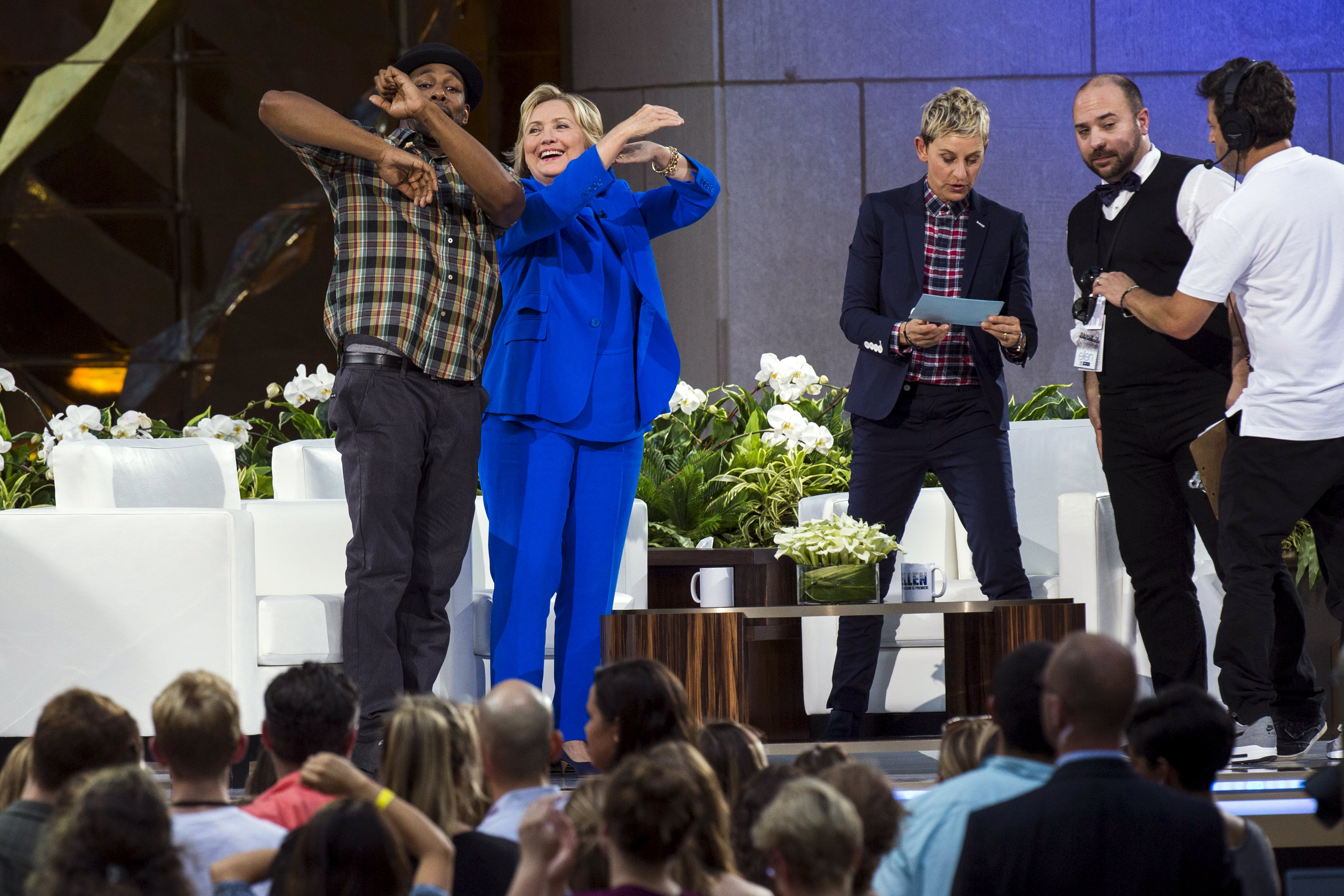 U.S. Democratic presidential candidate Hillary Rodham Clinton dances with DJ Stephen 'Twitch' Boss next to television host Ellen Degeneres during a taping of 'The Ellen Degeneres Show' in New York Tuesday. | REUTERS