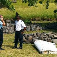 Wing part found on Reunion beach is from missing MH370, French investigators confirm