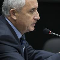 Ousted Guatemalan President Molina tells court he is innocent of graft