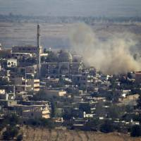 Israel shells Syrian positions after rocket lands in Golan field