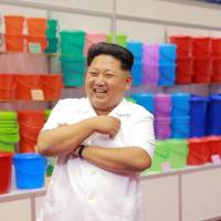 North Korean leader Kim Jong Un tours an exhibition in this undated photo released by the state-run Korean Central News Agency on Tuesday. | REUTERS