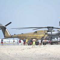 Hard helicopter landing claims Marine, injures 11
