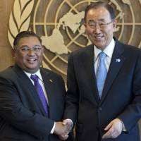 U.N. Secretary-General Ban Ki-moon (right) meets with Myanmar's Foreign Minister Wunna Maung Lwin ahead of the United Nations General Assembly at the U.N. headquarters in New York Thursday, when the Myanmar minister defended his country's barring of ethnic Rohingya from voting. | REUTERS