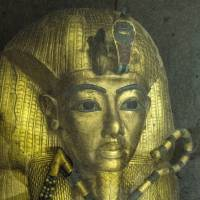 The golden sarcophagus of King Tutankhamun is seen in his burial chamber at the Valley of the Kings, near Luxor, Egypt, on Tuesday. Standing before the majestic gold, ochre and white frescos of Tutankhamun's tomb, British archaeologist Nicholas Reeves defended his daring theory that Nefertiti is buried at the site. | AFP-JIJI