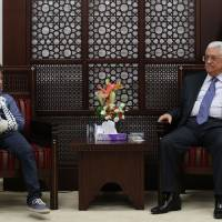 Palestinian Authority President Mahmud Abbas  receives at his headquarters in Ramallah on Wednesday 11-year-old Mohammed Tamimi, who was detained by an Israeli soldier during a weekly demonstration in the West Bank village of Nabi Saleh. Footage of the incident, which took place on Aug. 28 in the Israeli occupied West Bank, went viral, generating a bitter debate both online and off. The Tamimi family has been at the forefront of the protests in the Palestinian village. It was reported Thursday that a draft U.N. resolution to raise the Palestinian flag by the time Abbas visits the U.N. this month is likely to pass. | AFP-JIJI